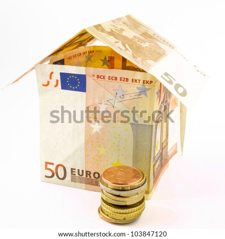 Money house with coins