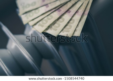 Money hryvnia banknotes ukrainian on the radiator. The start of the heating season. The warmth and comfort of the home. Heated the room. Ecological heating systems.