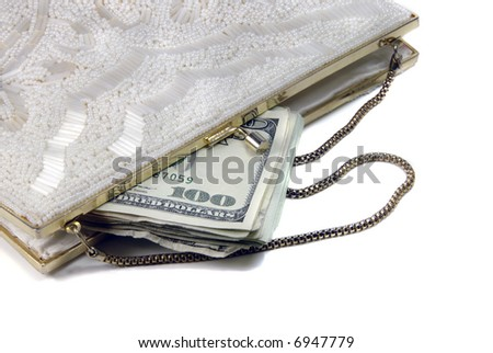 Money in a fancy, white, beaded purse.