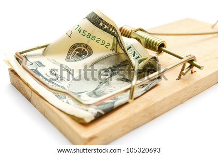Money in a mousetrap. On a white background.