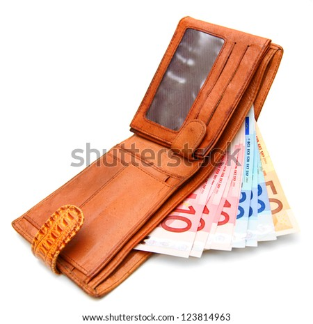 Money in a purse. On a white background.