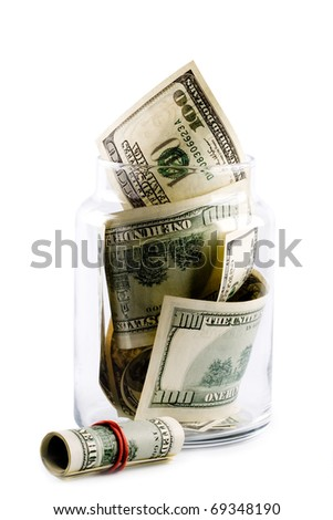 money in glass jar isolated on whiter background