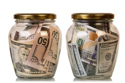 Money in glass jars, isolated on white background