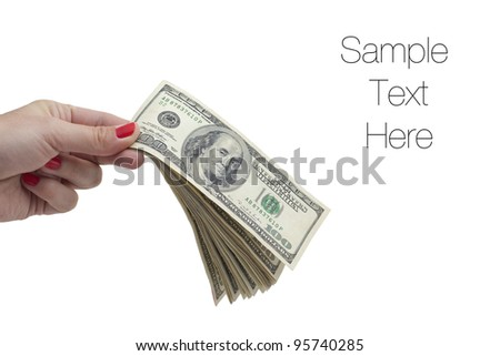 Money in hand, A woman holding stack of one hundred dollar bills in her hands, isolated on white, copy space