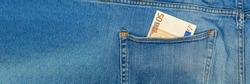 Money in my jeans pocket, 50 Euros in the back pocket of blue jeans. Wealth and prosperity concept. Place for text. Copy space.
