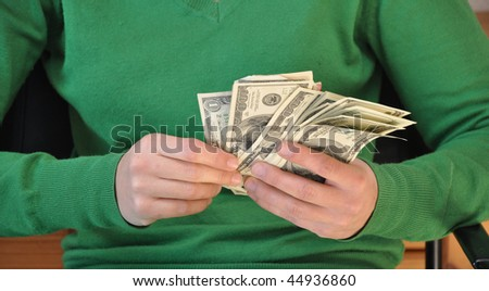 Money in the hands of a young woman