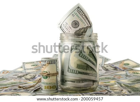 Money in the jar placing on US dollar banknotes