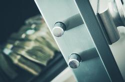 Money in the Residential Safe Box Closeup Photo. Cash Money Safe Deposit.