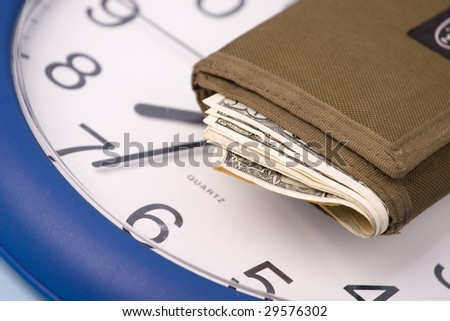 money in wallet and clock