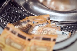 Money in washing machine, closeup view. Money washing. Money laundering