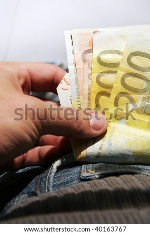 money is looking out of the trousers pocket