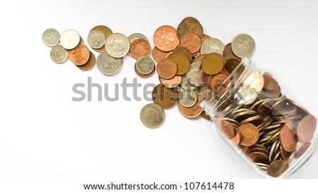 money jar emptied over white background
