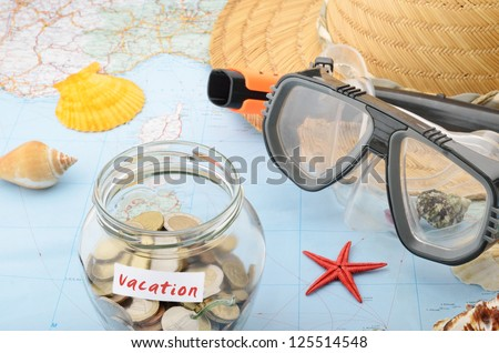 Money jar on a map concept for vacation costs and savings