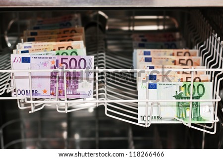 money laundering in the dishwasher with banknotes