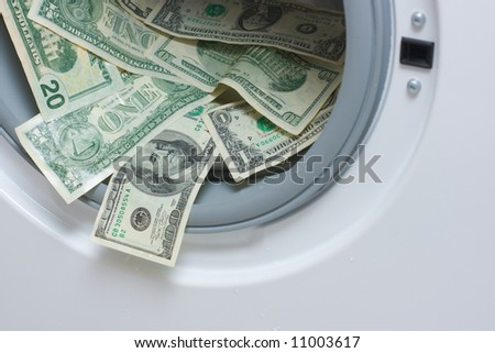 Money laundering. Money cleaning concept. Washing US dollars