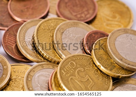 Money laundering on clothesline on light background. Handful of coins. Scattering of coins. Euro cent coins  Stock photo ©
