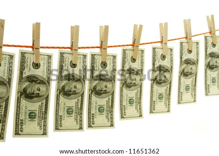 Money londering on string with clothespins isolated on white background
