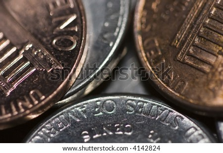money macro photograph of pocket change focus near the center then blurring towards the edges