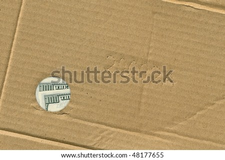 stock-photo-money-making-from-recycling-concept-cardboard-with-cut-out-hole-and-a-few-hundreds-dollars-in-it-48177655.jpg