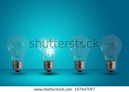 Money making idea. Yen symbol glow among other light bulb on a blue background