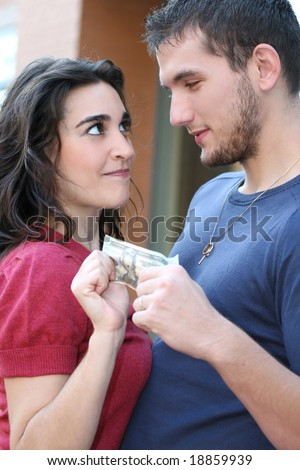 Money matters: young couple / family arguing over money. Suitable for a variety of financial crisis, budget, family themes