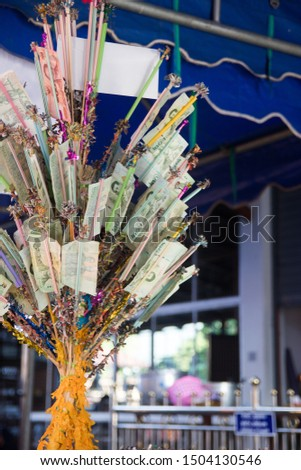 money offerings for monk in Thailand Thot Kathin ceremony.