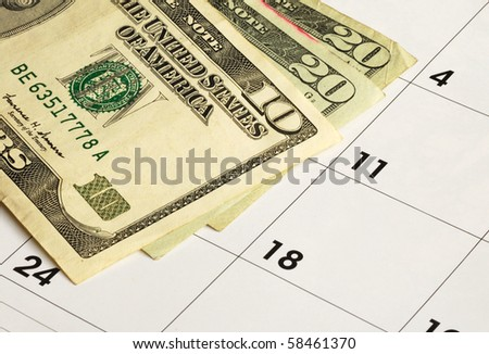 Money on a calendar concepts of financial planning