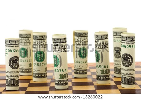 Money on chess board, isolated on white background