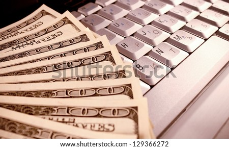 money on computer keyboard