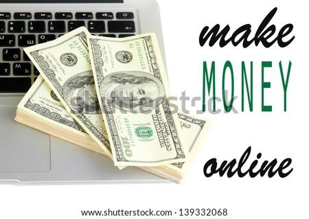 Money on laptop isolated on white