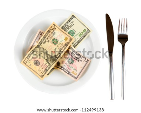 Money on plate isolated on white background close-up