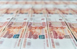 Money on Russia. Close-up of Russian rubles on five thousand and one thousand banknotes. Finance concept.