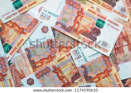 Money on Russia. Close-up of Russian rubles on five thousand banknotes. Finance concept.  #1174590610