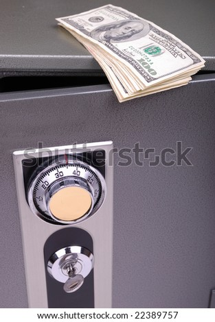money on the safe - stock photo
