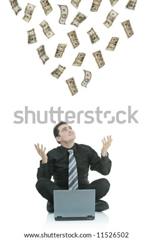Money raining down on a businessman with a laptop