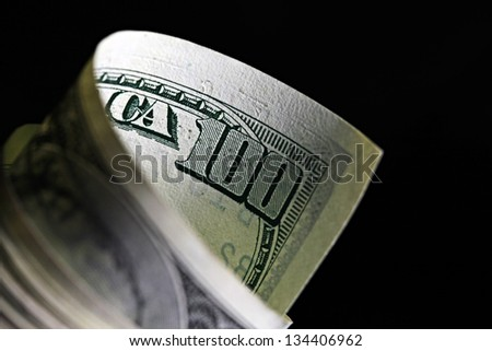 Money roll with US dollars - stock photo