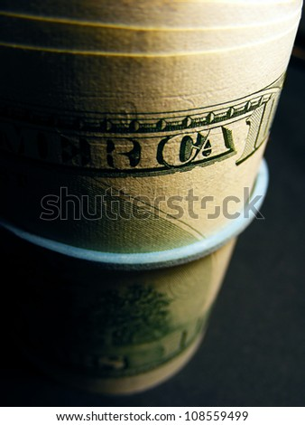 Money roll with US dollars. Selective focus.