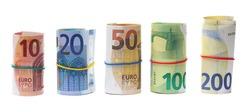 Money rolls, rolled up euro banknotes, bills of various monetary values tied up with rubber band isolated on white background