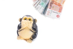 money rubles of different denominations and a piggy bank on a white background