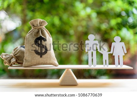 Money saving for kids, family financial wealth management concept : Dollar or cash in hemp bags or burlap sacks and a white paper cut (dad, mom and son) on wood balance scale. Green nature background. #1086770639