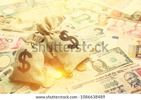 Money saving, investment and rich or wealth management concept : US dollar or cash in hemp bags or burlap sacks and coins, depicts prosperous person or millionaire has a lot of money. Notes background