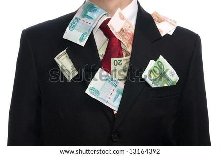 Money stuffed under business man's suit