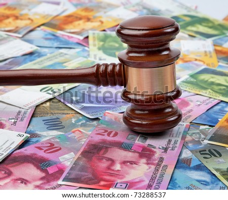 Money Swiss francs and a gavel. Legal costs in Switzerland