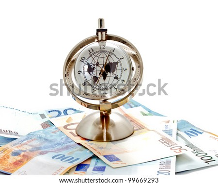 money, time and globalization concept; global model clock with Euro banknotes on white background
