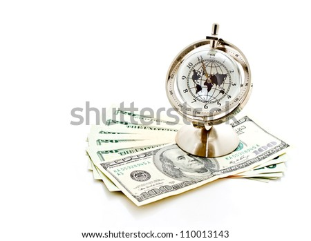 money, time and globalization concept; global model clock with US dollar banknotes