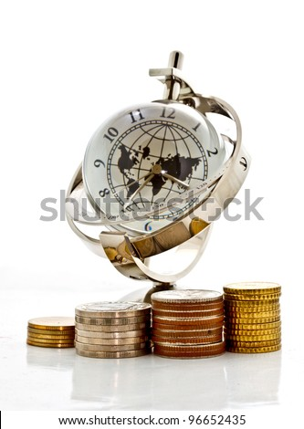 money, time and globalization concept, towers of coins with the global model clock on white background