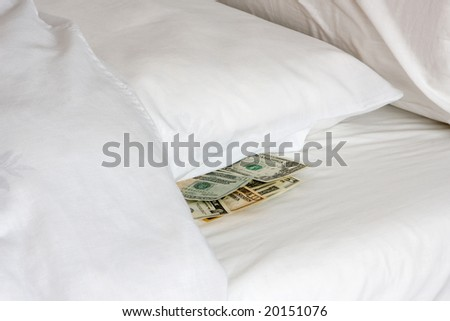 Money tucked away under a pillow during financial crisis