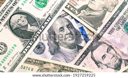 Money, US dollar banknotes background. US dollar bills scattered on a table. Close-up photo. Finance, Business and Economy concept.  Zdjęcia stock ©
