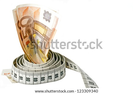 Money with a tape measure wrapped around it over a white background