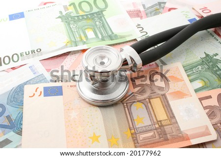 money with stethoscope isolated on white